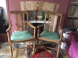 2 wooden oak dining chairs with arms