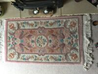 Quality 100% wool rug in very good condition