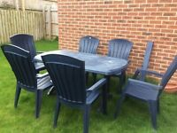 Blue plastic garden table and six matching chairs. Dark blue plastic. Good condition. £30