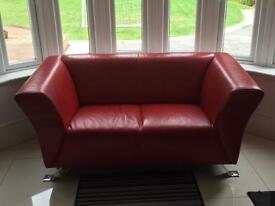 2 x 2 seater red sofas