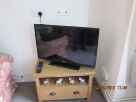 SMALL WOODEN TV UNIT OR CABINET WITH SHELF AND TWO PULL OUT DRAWERS - ONLY 6 MONTHS OLD.