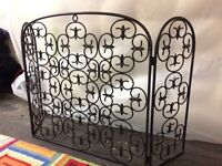 Black wrought iron fire screen