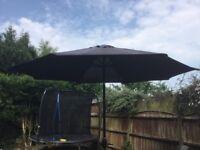 Black parasol and metal base