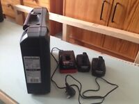 Metabo batteries and charger for cordless drill.