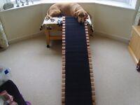 Wooden folding dog ramp.