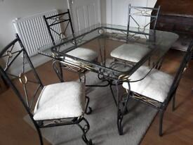 Glass topped table & chairs