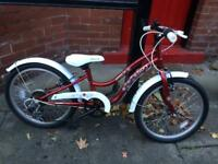 Children's red bicycle