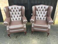 Pair of brown Chesterfield wing chairs
