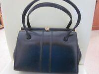 Black Vintage Ladies Handbag with Elbief frame and snap clasp