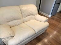 REDUCED- Cream leather two seater sofa
