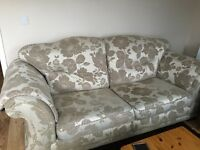 Lovely large beige floral patterned sofa