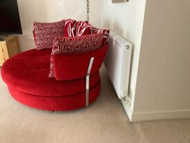 Large red swivel sofa/snuggler