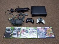 Xbox 360 with two controllers kinect accesories and games