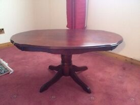 Dark wood oval coffee table