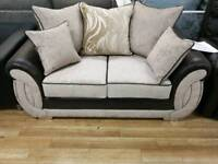 Beautiful cream fabric and black faux leather sofas