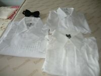 3 white mens dress shirts and a black bow tie