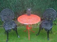 heavy garden table and chairs in metal,paint is peeling on table and chairs will need rubbing down