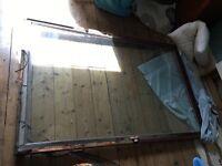 70s/80s double glazed pivot window - glass ok but wood damaged. Was in Victorian tenement