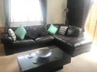 Brown/black leather sofa and arm chair