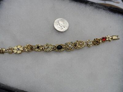 Vintage/NOS stunning gold tone charm slide bracelet #3073