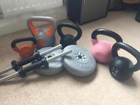 Assortment of kettle bells and dumbells