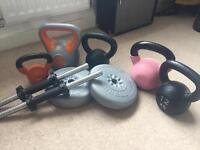 Assortment of kettle bells and dumbells