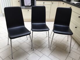 3 black dining chairs