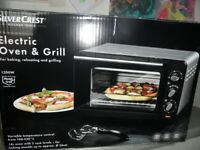 Oven & Grill . Boxed never been used LIKE NEW