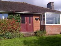 3 bed unfurnished, detached bungalow, surrouded by its garden in a secluded, rural setting