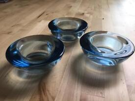 Three blue glass tea light candle holders