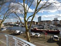 A spacious 2 bedroom apartment in a dockside development with a balcony in Canada Water.