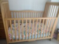Cot bed. Bedside cot. Made by Brio. Adjustable height and side