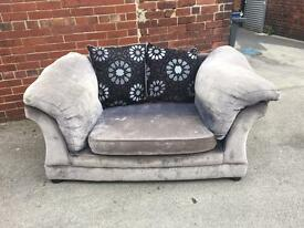 Small two tone two seater sofa