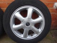 Set of 4 mini alloy wheels + tyres + centre caps.