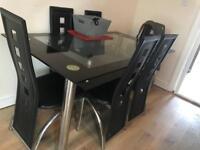 Black glass table seats 6