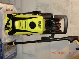 Pressure washer by Wolf with sky reacher attachment