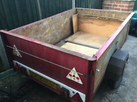 Approx. 6ft x 4ft wooden car trailer, needs attention.