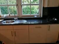 Kitchen, worktop and AEG hob and double oven, fridge freezer, dishwasher and sink