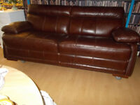 Choc brown luxury sofa armchair and storage pouffe .