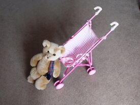 Toy buggy and teddy bear