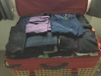 A large suitcase full of ladies clothes sizes 12-14