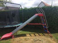Red and chrome garden slide