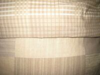 Single duvet and duvet cover 135cm x 200cm. 10.5 tog. Brown checks on either side. Never used.