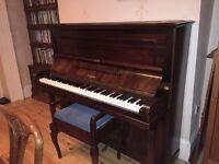 Beautiful piano and stool