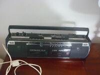 Portable radio + cassete player (small ghetto blaster!)