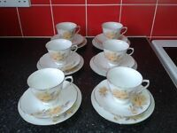 set of cups, saucers and side plates