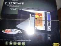 Silver Crest Microwave oven with grill. Microwave output 800 w Grill 100 w in original box, unused.