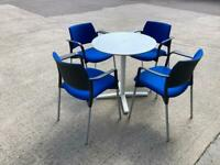 White coffee table and 4 matching blue chairs