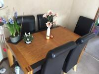 Table & 6 faux leather chairs