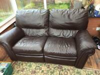 Two seater brown leather sofa recliner